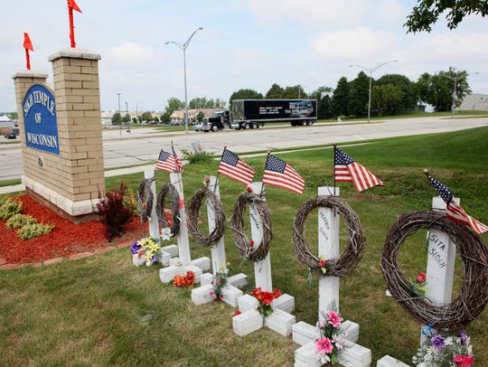 Flags are memorials stand outside the Sikh Temple of