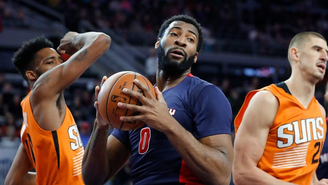 Pistons center Andre Drummond rebounds against the Suns at the Palace on March 19, 2017.