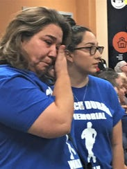 Family of Coach Archie Duran wipe away tears Tuesday when a new school was named for Duran who died in 2017.