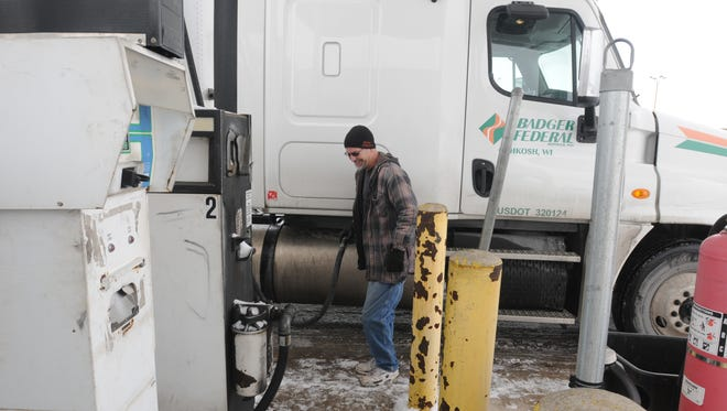 Paul Hogan, regional driver for Badger Federal, puts diesel fuel in his truck before heading out on a run.