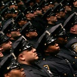 New York City police officers attend a graduation ceremony in June 2006.