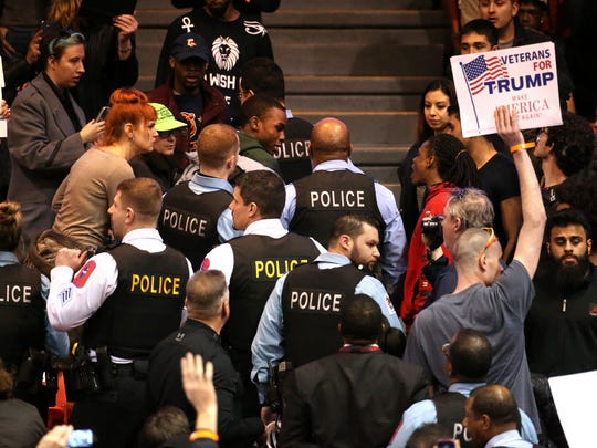 A demonstrator is removed by Chicago police during a rally for Republican presidential candidate Donald Trump at the University of Illinois at Chicago Pavilion in Chicago on Friday, March 11, 2016.