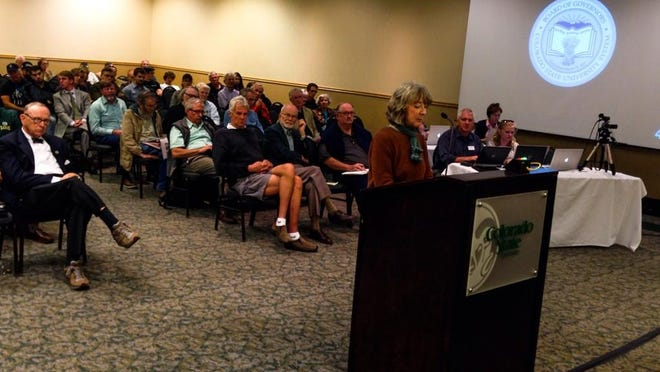 Citizens make comments at the CSU board of governors meeting discussing the stadium.