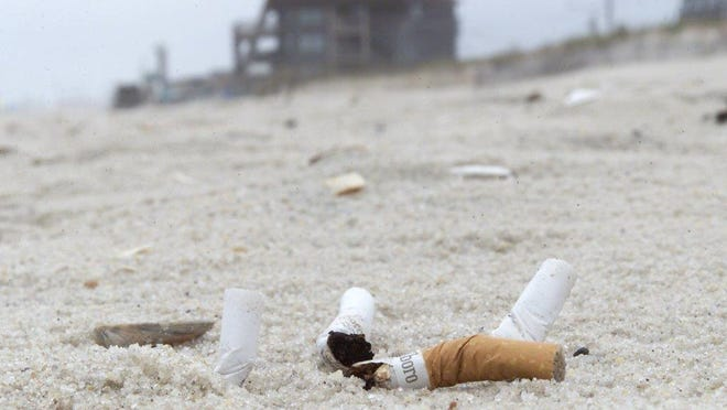 A bill that would ban smoking at beaches and state-owned parks is on Gov. Chris Christie's desk.   FILE PHOTO