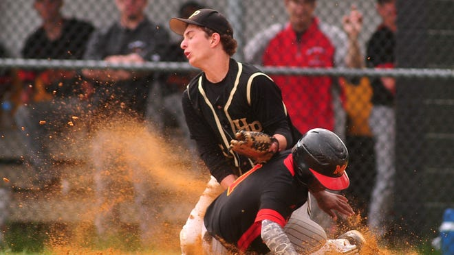 Hanover Park relief pitcher Donato Casolaro covers home as Mount Olive's Marcus Judd successfully steals home.