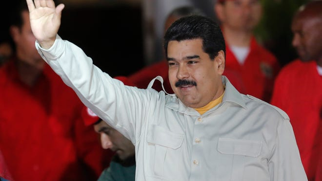 Venezuela's President Nicolas Maduro greets supporters during an event at the Miraflores Presidential Palace in Caracas, Venezuela, on Feb. 19.