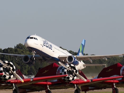 """The """"BluesMobile,"""" an Airbus A321 flown by JetBlue,"""