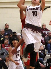 Tularosa's Bethany Betancur puts up a shot in the paint Saturday.