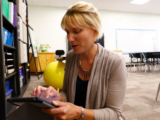 Second grade teacher Jaime Laffin sets up a school iPad during Tuesday's open house at Thomas Jefferson Elementary School in Wausau.