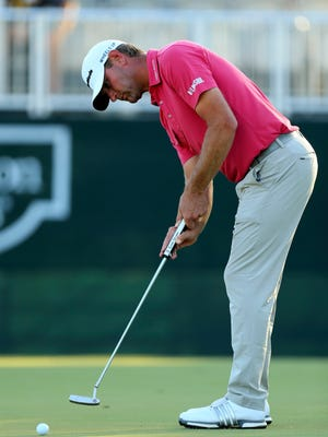 Oct 29, 2016; Jackson, MS, USA;  Lucas Glover putts the ball on the green of the eighteenth hole during the third round of the Sanderson Farms Championship at Country Club of Jackson.