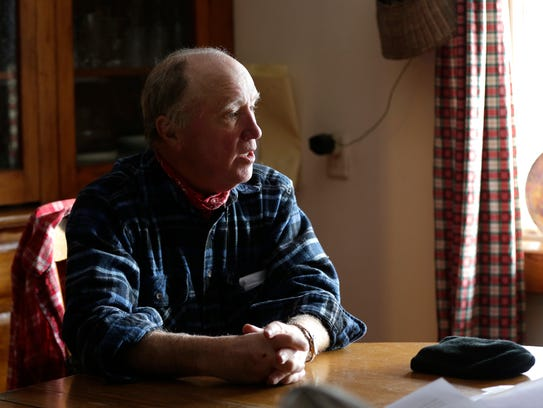 Donald Isherwood talks in his home about his trout