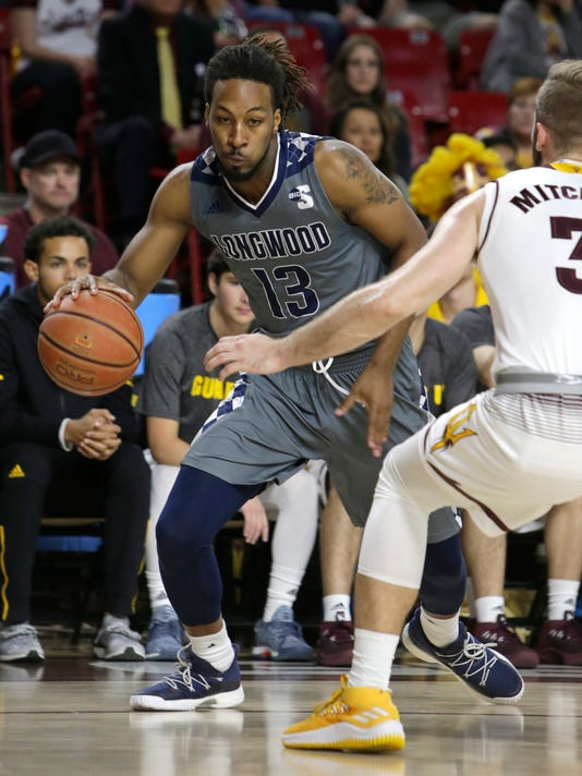 Longwood forward Spencer Franklin (13) drives on Arizona State forward Mickey Mitchell in the first half during an NCAA college basketball game, Tuesday, Dec 19, 2017, in Tempe, Ariz. (AP Photo/Rick Scuteri)