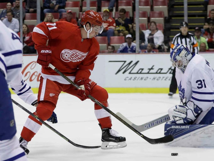 Detroit Red Wings center Dylan Larkin shoots the puck