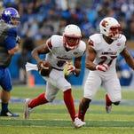 Louisville quarterback Lamar Jackson escapes for a long run in the second half. Nov. 28, 2015.