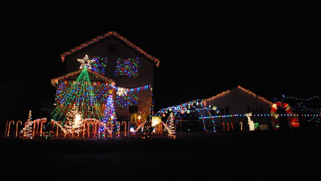 Derek Harper's house, 520 S. Main St., is lit up with hundreds of Christmas lights, which dance to the music on 88.5 FM.
