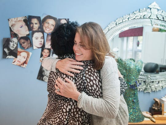 Breast cancer survivor Marcy Parker, right, hugs Rose Marie Beauchemin, owner and founder of The Beau Institute in Mount Laurel, which offers permanent makeup services, including what Beauchemin might be best known for; Areola tattooing, a final, convincing step in breast reconstruction for breast cancer survivors who have had mastectomies.  Parker visited Beauchemin at the Beau Institute recently for a check-up. 10.08.15