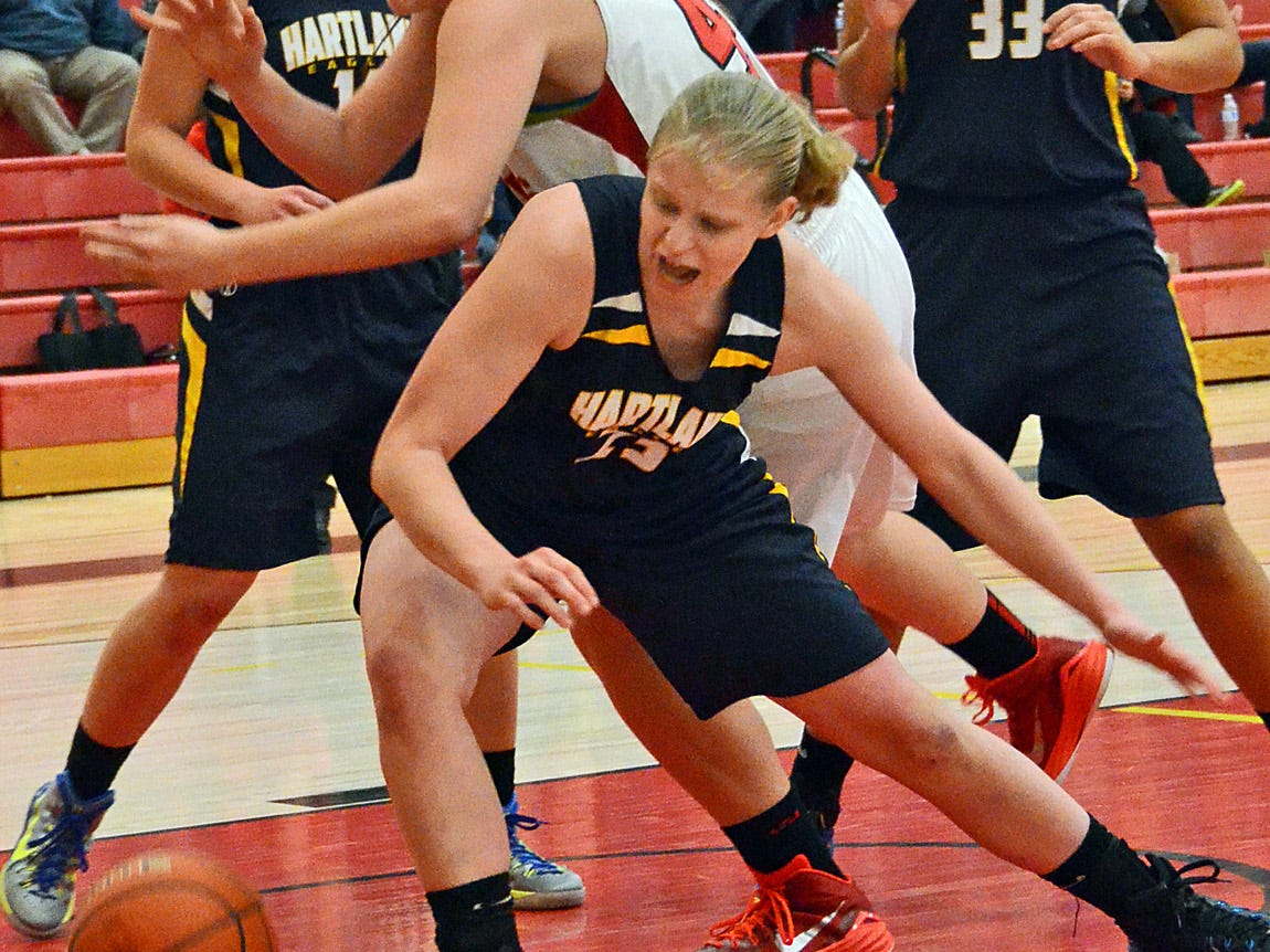 Hartland's Ryann Laier (23) and Pinckney's Jamie Katschor (40) go after a ball while Hartland's Natalie Halonen (11) and Graysen Cockerill look on in the first half of Tuesday's game.