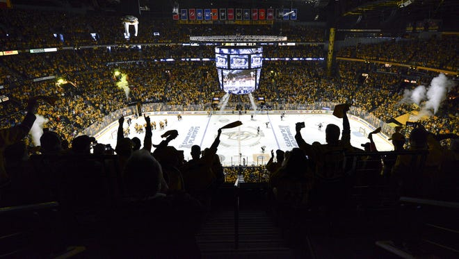 Fans celebrate after the Predators' victory over the St. Louis Blues at Bridgestone Arena during the 2017 playoffs.