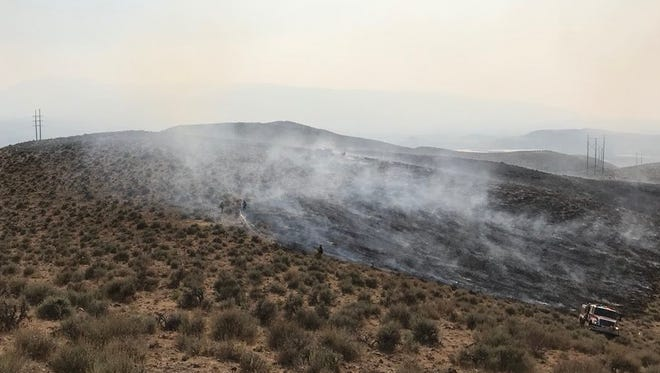 The Rio Wrangler Fire burned 14 acres near a gun club southeast of Reno on Saturday, July 28, 2018.
