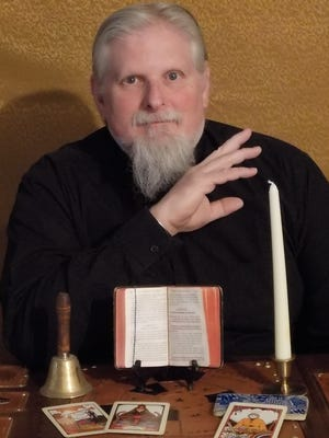 Pete McMillan poses with artifacts used in his Spirius Dictum seance.