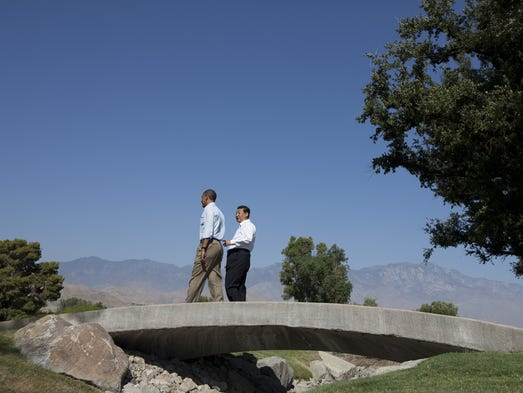 President Barack Obama, left, walks with Chinese President Xi Jinping at the Annenberg Retreat at Sunnylands on Saturday, June 8, 2013, in Rancho Mirage.