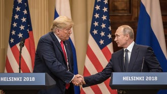 President Donald Trump and Russian President Vladimir Putin shake hands during a joint press conference after their summit.