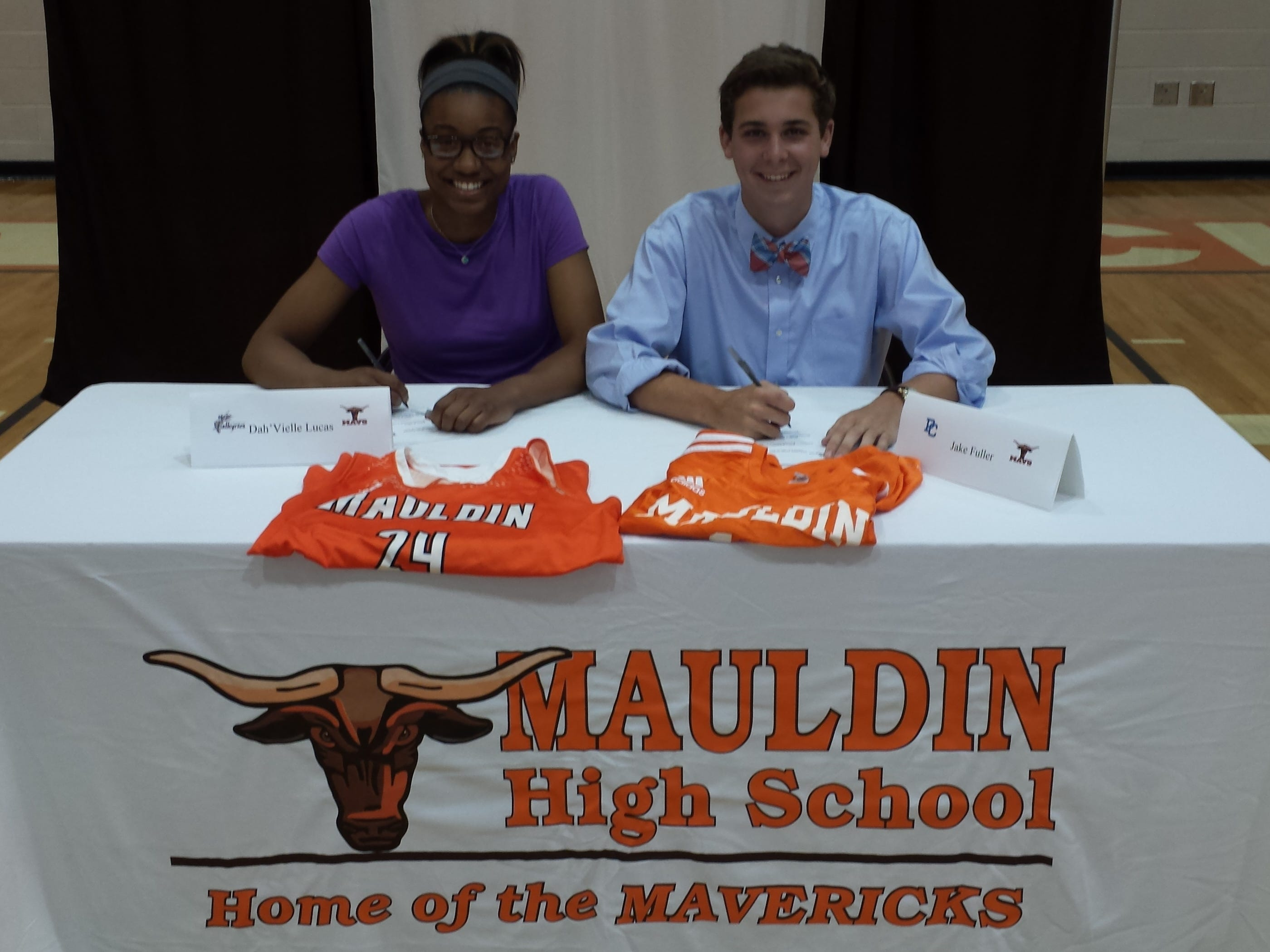 Mauldin High seniors Dah'Vielle Lucas, left, and Jake Fuller signed scholarships, Lucas with Converse College for basketball and Fuller with Presbyterian College for soccer.
