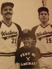 As pictured in the 1986 Western Hills High School yearbook are head coach Ken Selby, left, and captain Jerry Schoen, right, along with bat boy Jeff Selby.