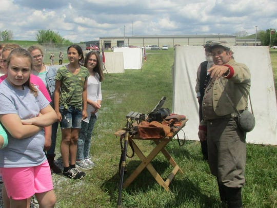 Re-enactors from Porters Battery tell students stories