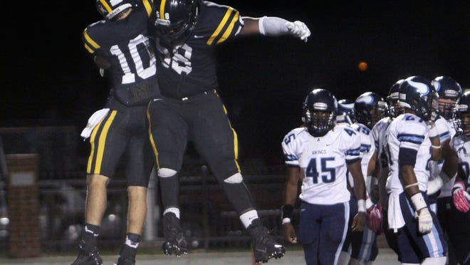 Neville Tiger T.J. Lemoine celebrates his touchdown with teammate Donald Louis (58) during Friday's homecoming game against Airline.