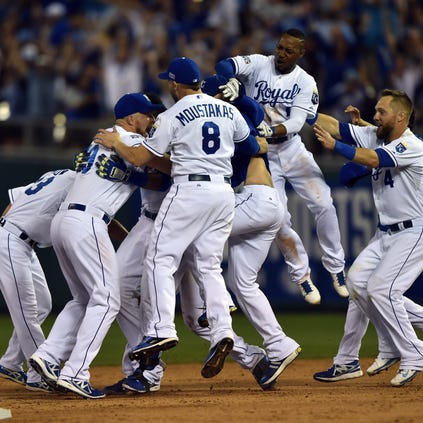 The Kansas City Royals celebrate after catcher Salvador Perez (13) hit a walk-off single against the Oakland Athletics during the twelfth inning of the 2014 American League Wild Card playoff baseball game at Kauffman Stadium. The Royals won 9-8.