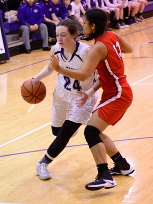 Brooklyn Baptista handles the ball Monday for Fremont Ross.