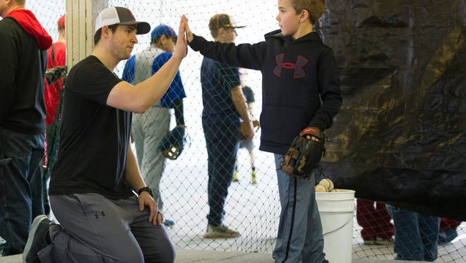 Philadelphia Phillies pitcher and Mater Dei graduate Jerad Eickhoff  high fives Hayden Titzer, 8, of Glenville, during a baseball clinic at Brittons Bullpen in Boonville, Thursday, Dec. 29. 2016.