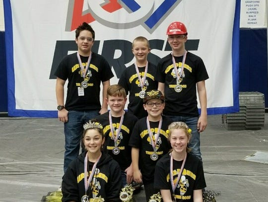 Members of the Memphis Wild Bees robotics team pose