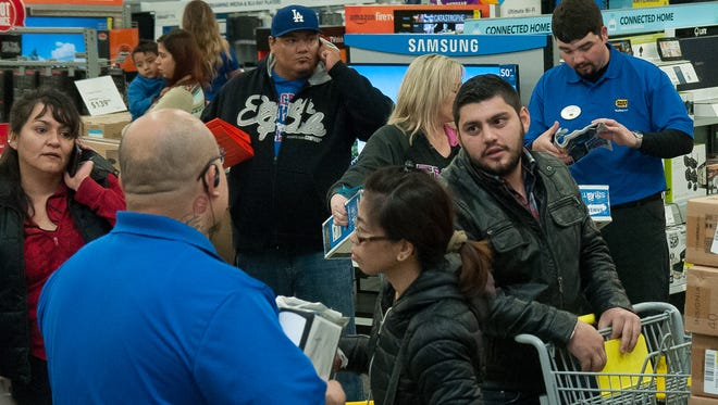 Las Cruces shoppers take advantage of Thanksgiving Day deals at Best Buy on Thursday.