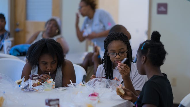 Kids at the Escambia County Play, Learn, Grow Summer Camp are fed a wholesome lunch and a snack.