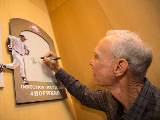 Former Tigers shortstop and future Hall of Fame inductee Alan Trammell touches the spot where his plaque will hang in the Plaque Gallery after he is inducted to the Baseball Hall of Fame on July 29. Trammell visited the Hall of Fame on Thursday, March 15, 2018.