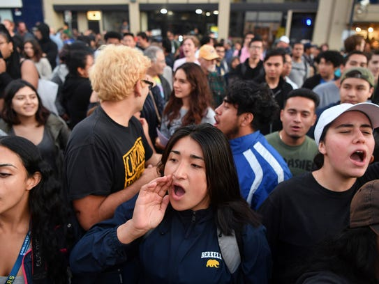 Protesters shout before a speaking engagement by Ben Shapiro on the campus of the University of California Berkeley.