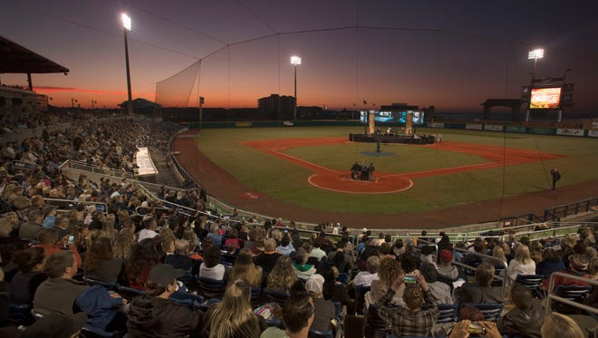 Worshipers gather at Blue Wahoos Stadium Easter Sunday, April 1, 2018 during the Marcus Pointe Baptist Church Community SonRise Service.