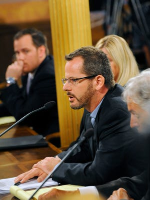 State Rep. Todd Courser speaks to the House Select Committee alongside his attorneys at the Capitol Wednesday.