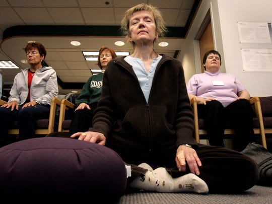 Participants in a University of Wisconsin Mindfulness Meditation class meditate at the UW Health sports Medicine clinic in 2005.