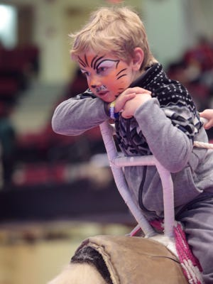 Noah Feffer, 4, of Scarsdale peers over the back of a camel at the Royal Hanneford Circus  41st Annual Show at the Westchester County Center in White Plains on Feb. 14, 2016.