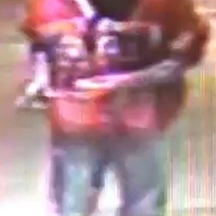 Police are seeking this person of interest in connection with an armed robbery.