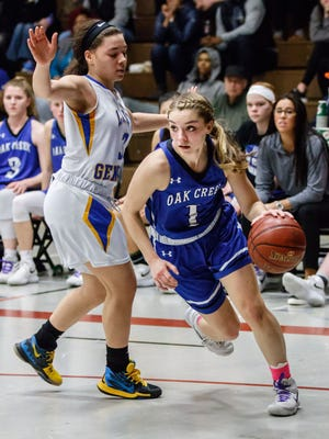 Oak Creek senior Haley Zylka (1) drives around King's Imani Colon during a WIAA Division 1 sectional final on Saturday afternoon at West Allis Central.