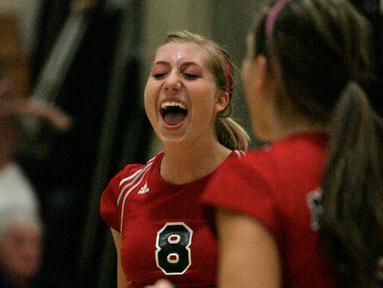 Muskego's Alli Glisch (8) and Kate LaTour (6), (right) react after scoring in the sectional in 2009. Eight years later, Glisch is leading the Mukwonago girls volleyball team to its first state appearance as head coach.