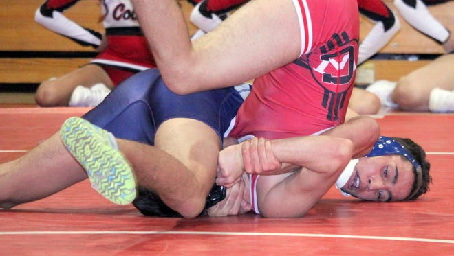 Silver's Vinnie Vega tallies a pin over Cobre's Tristin Vigil at 160 pounds in Wednesday night's dual meet action in Bayard.
