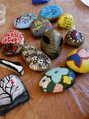 A sampling of the rocks painted by Visalia Rocks! group members on Tuesday. They will be hidden around town for others to find.