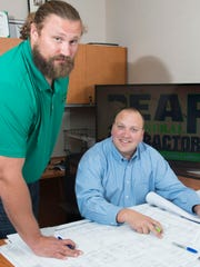 Josh Sitton, left, and Chris Jaubert, right, started Bear General Contractors two-years ago and are working on several local projects including the Studer's drive-thru coffee location using shipping containers.