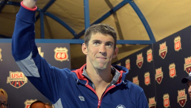 Michael Phelps reacts after placing second in the 200m individual medley at in the 2014 USA National Championships on Aug 10, 2014.