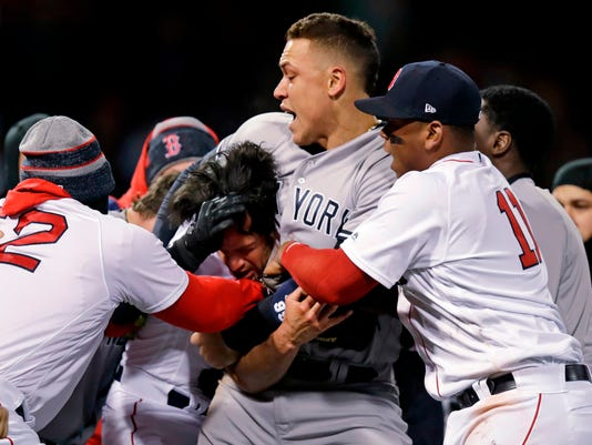 New York Yankees right fielder Aaron Judge puts Boston Red Sox relief pitcher Joe Kelly in a headlock after Kelly hit Yankees' Tyler Austin with a pitch during the seventh inning of a baseball game at Fenway Park in Boston, Wednesday, April 11, 2018. (AP Photo/Charles Krupa)